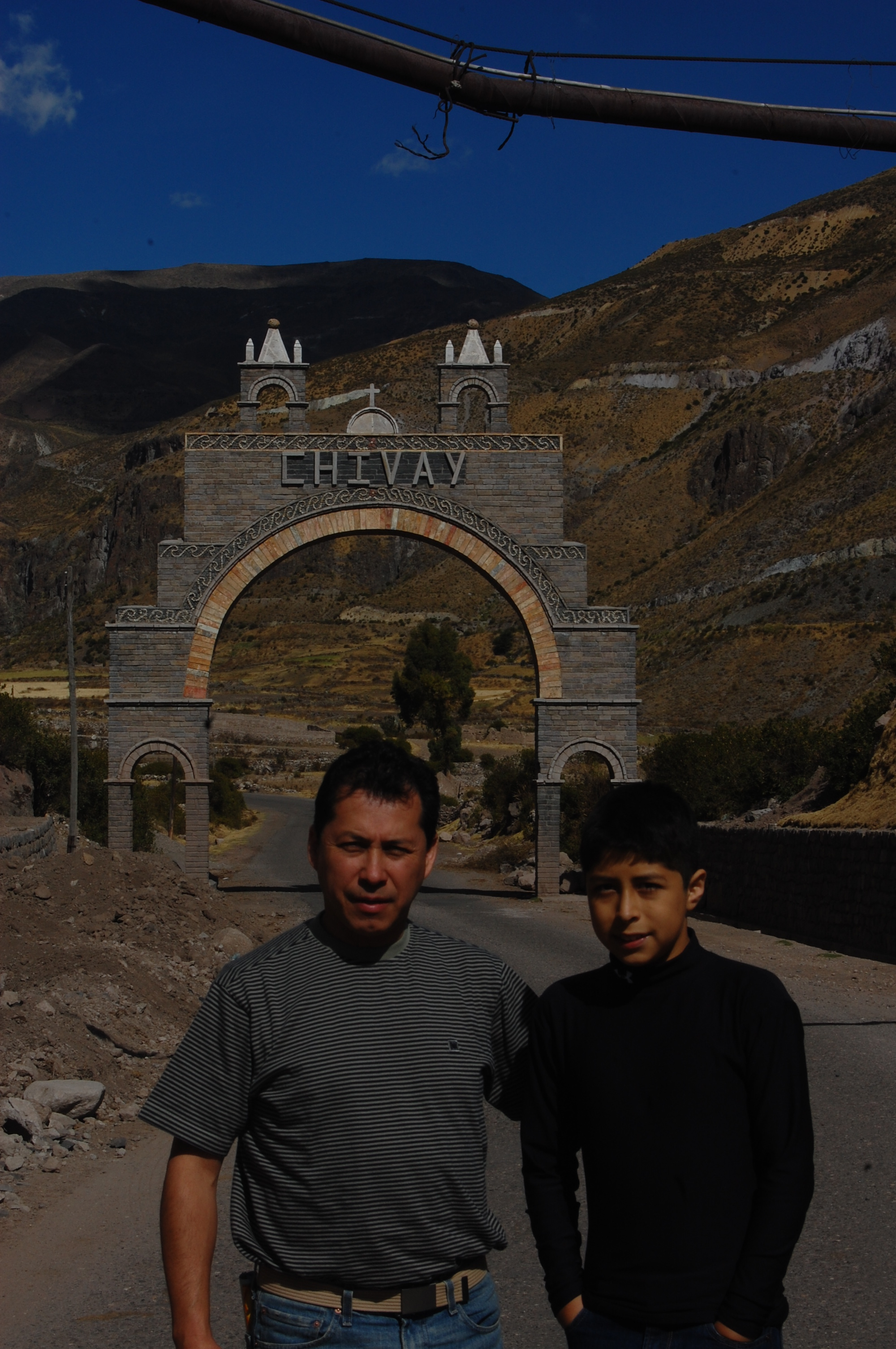 Richard and Chris with this call arch spanning over the highway into Chivay