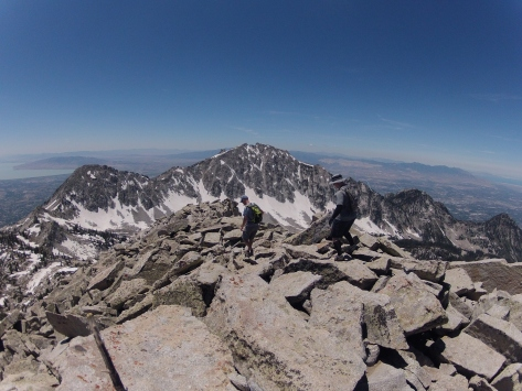 Bikman and Goff just below the summit, with Big Horn and Lone Peak behind
