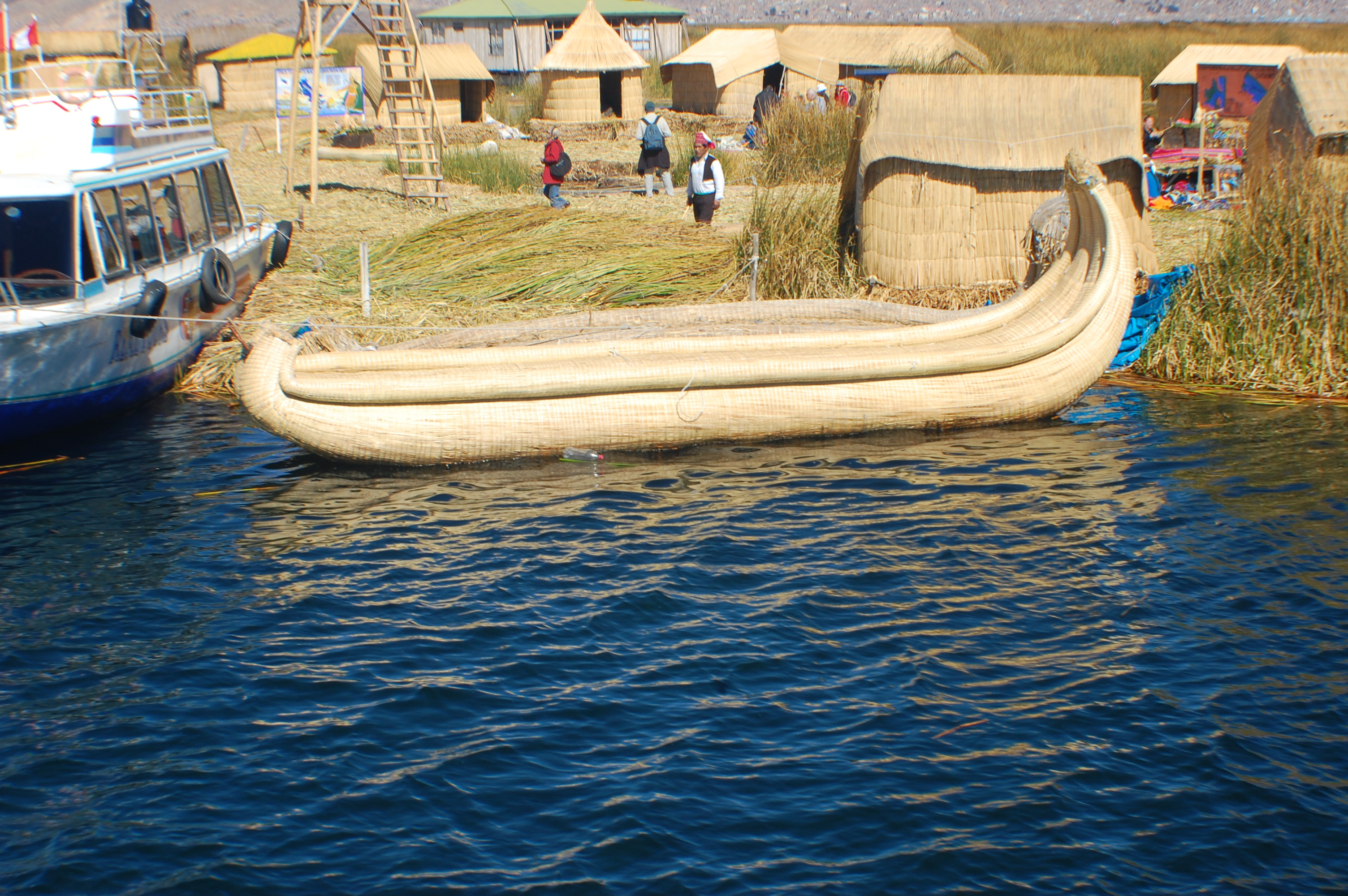 """We rode in these super cool reed boats. I bought a couple really colorful 5"""" replicas to take back home"""