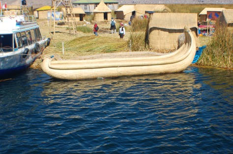 "We rode in these super cool reed boats. I bought a couple really colorful 5"" replicas to take back home"